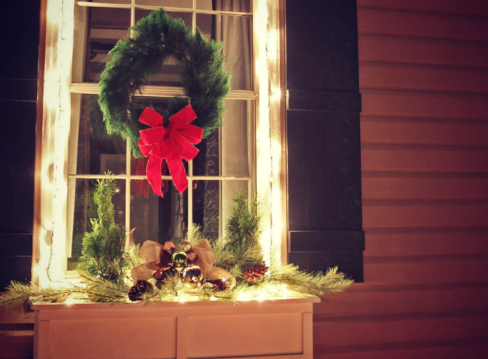 The easiest Christmas window box idea ever! From Jennifer Decorates.com